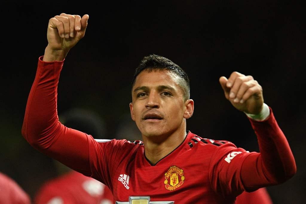 Alexis Sanchez merayakan golnya ke gawang Newcastle United (AFP/Oli Scarff)