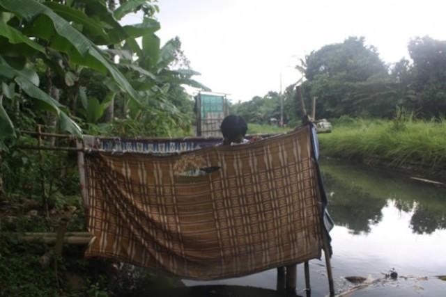 Ilustrasi jamban di pinggir sungai, Medcom.id - Kuntoro