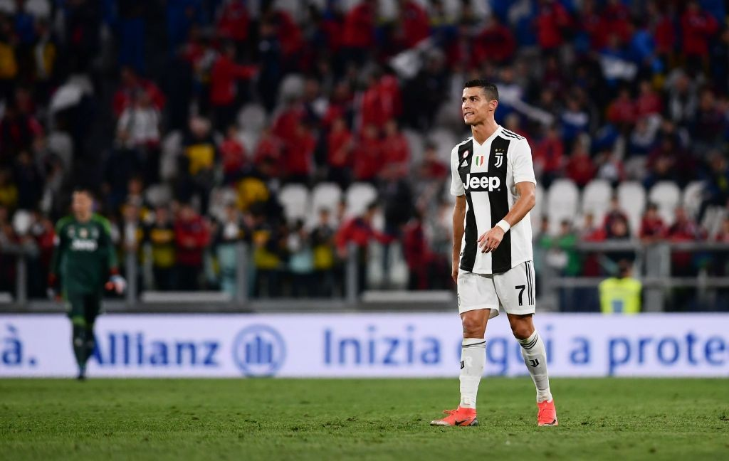 Ekspresi kekecewaan Cristiano Ronaldo usai Juventus ditahan imbang Genoa (Foto: AFP/Marco Bertorello)