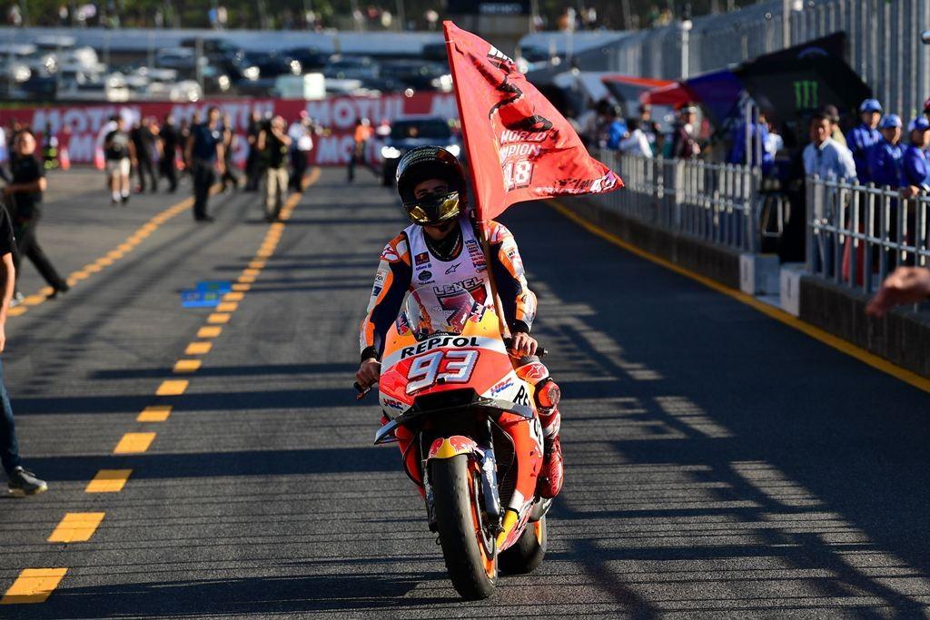 Selebrasi kemenangan Marc Marquez (Photo by Martin BUREAU / AFP)