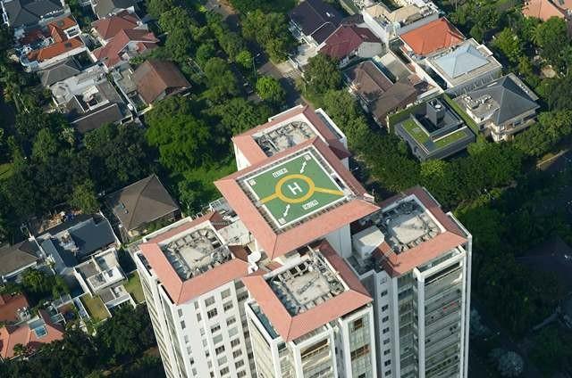 Helipad di atap tower apartemen mewah di Jakarta Selatan. Sebelumnya pemerintah juga akan memangkas pajak barang mewah pembelian apartemen dan rumah tapak mewah. AFP Photo/Adek Berry