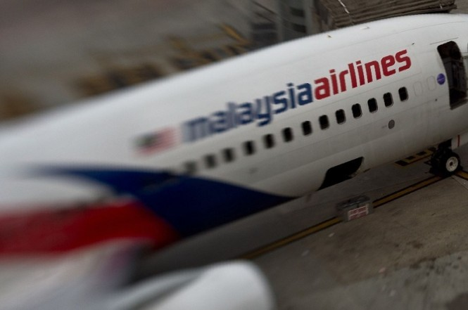 Sebuah pesawat Malaysia Airlines yang diparkir di Bandara Kuala Lumpur. (Foto: AFP).