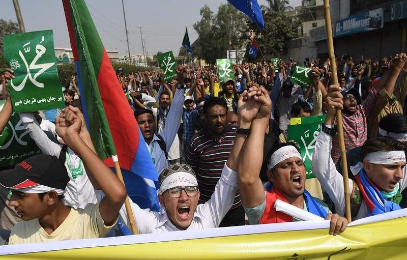 Protes warga Pakistan menentang vonis bebas kasus penodaan agama. (Foto: AFP)