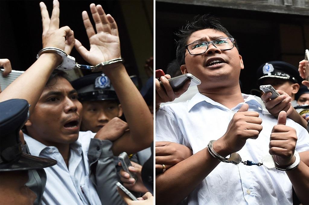 Dua jurnalis Reuters, Wa Lone (kanan) dan Kyaw Soe Oo. (Foto: AFP/YE AUNG THU)