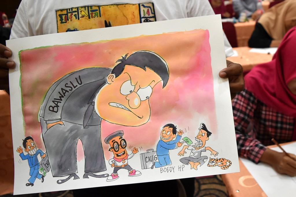 Aksi 100 Kartunis Jateng Kawal Pemilu