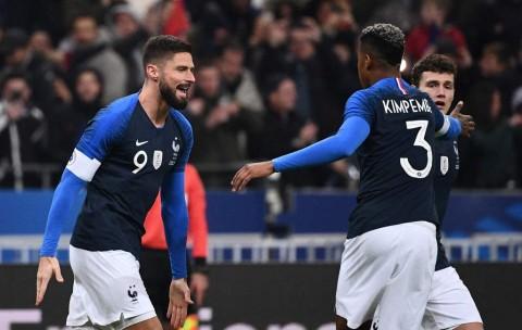 Giroud Bantu Prancis Gasak Uruguay