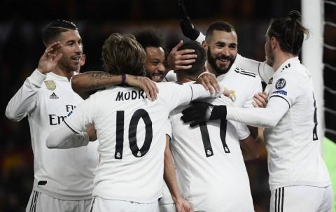 Permalukan Roma, Madrid Lolos Sebagai Juara Grup