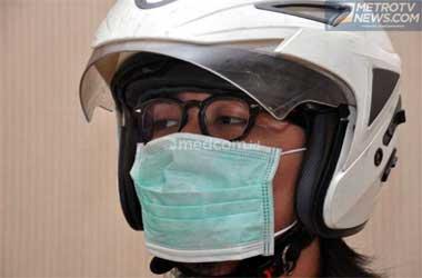Menggunakan masker seperti ini, tidak cocok untuk berkendara.