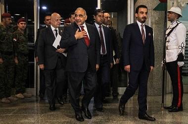 Adel Abdel Mahdi (tengah) berada di Baghdad, 24 Oktober 2018,
