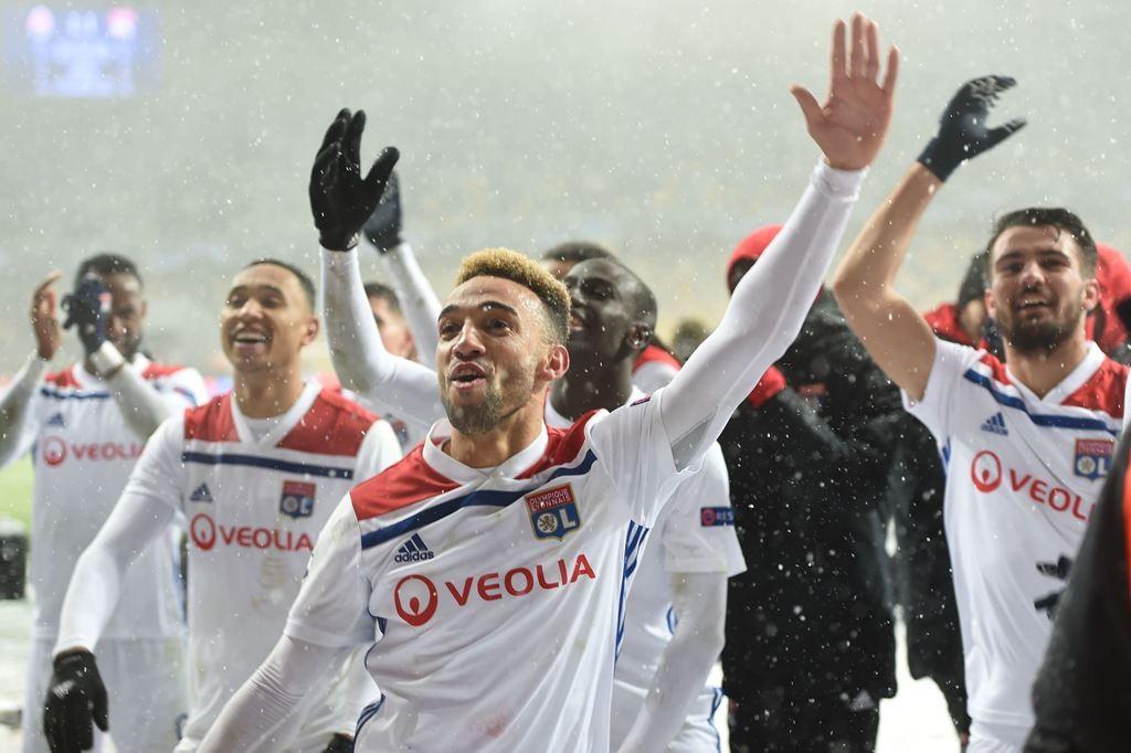 Skuat Lyon merayakan kemenangan atas Shakhtar Donetsk. (Foto: AFP/Sergei Supinsky)