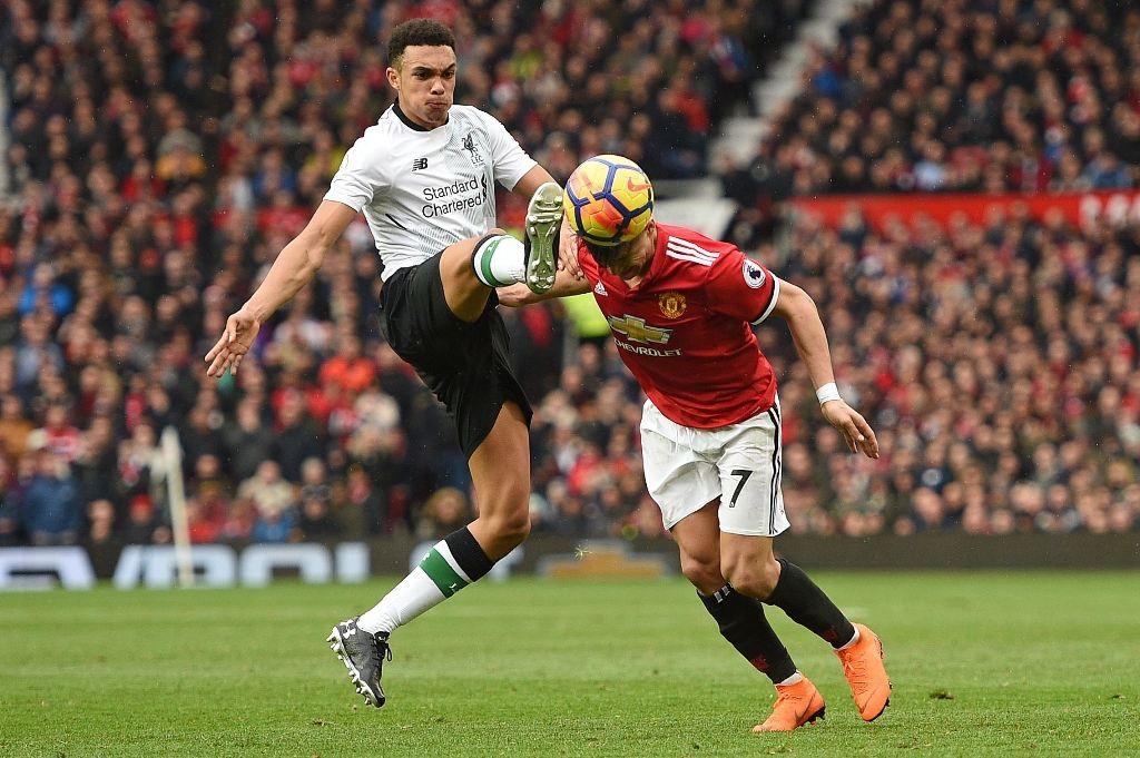Suasana laga Manchester United vs Liverpool. (AFP PHOTO / Oli SCARFF)