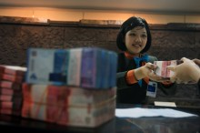 Rupiah akan Bergerak hingga Rp14.540/USD