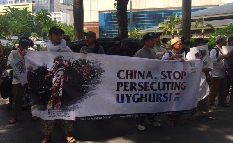 Protes warga menentang isu diskriminasi etnis Uighur oleh Tiongkok. (Foto: Kumara Anggita/Medcom.id).