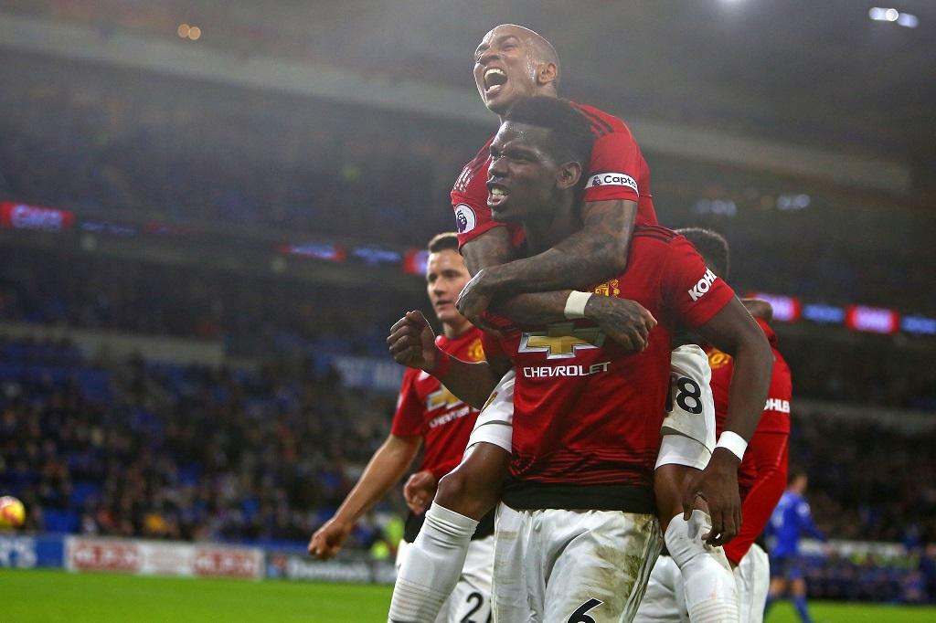 Para penggawa Manchester United merayakan gol ke gawang Cardiff (Geoff CADDICK / AFP)