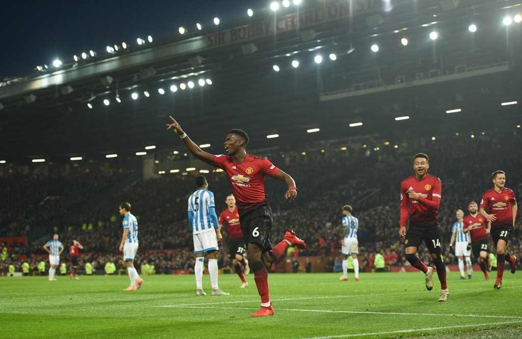 Selebrasi gol Paul Pogba usai membantu Manchester United mengalahkan Huddersfield 3-1 di laga Boxing Day Liga Primer Inggris 2018--2019 (Foto:  Oli SCARFF / AFP)