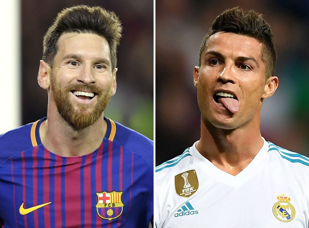 Lionel Messi (kiri) dan Cristiano Ronaldo (AFP PHOTO / Lluis GENE)