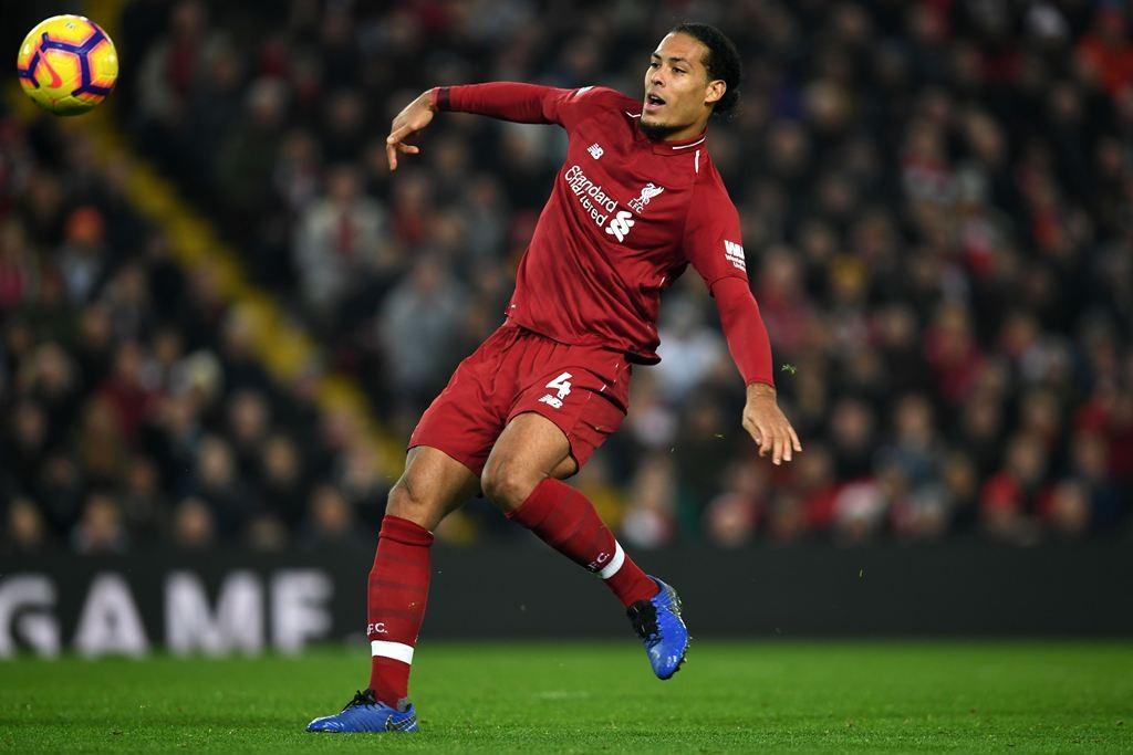 Bek Liverpool, Virgil van Dijk. (Paul ELLIS / AFP)