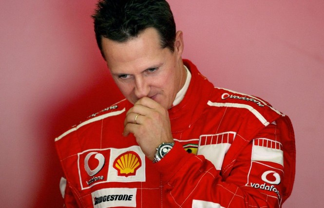 Pembalap F1 legendaris, Michael Schumacher. (JOSE LUIS ROCA / AFP)