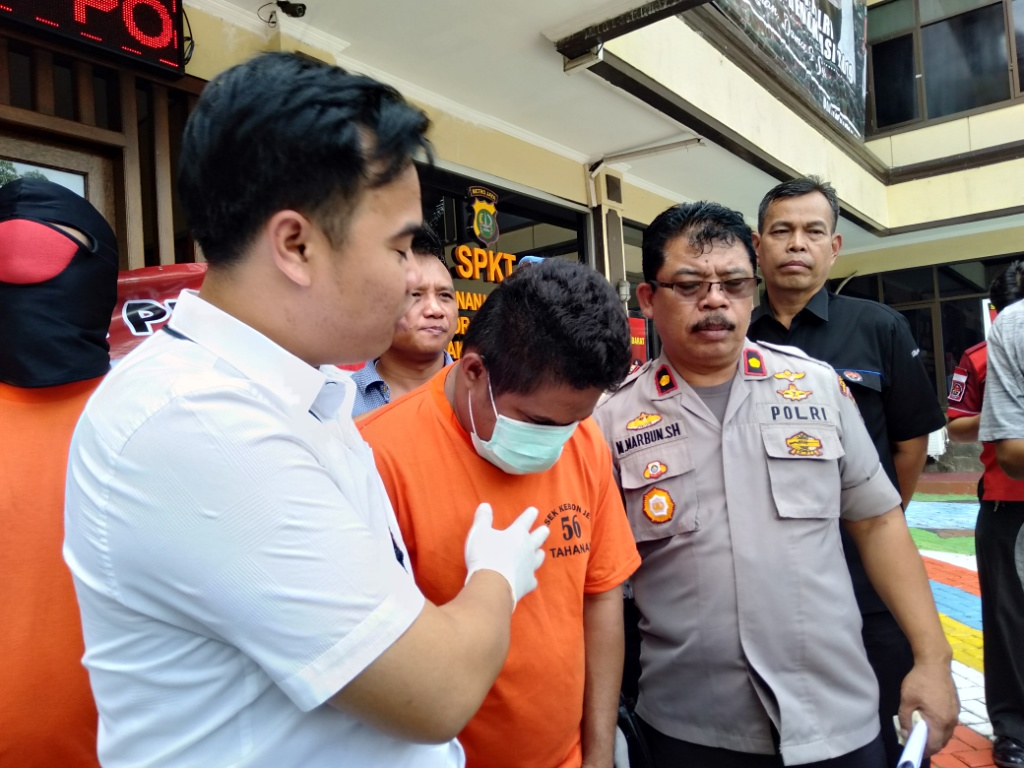ZK alias U, salah satu pembunuh pengunjung Diskotek Bandara, Kebon Jeruk, Jakarta Barat. Foto: Medcom.id/Sunnaholomi Halakrispen.