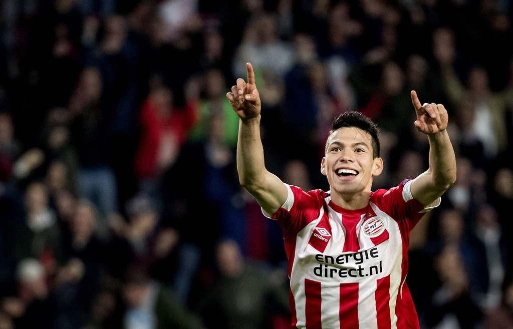 Hirving Lozano akan bertahan di PSV Eindhoven hingga musim panas (AFP/Koen van Weel)