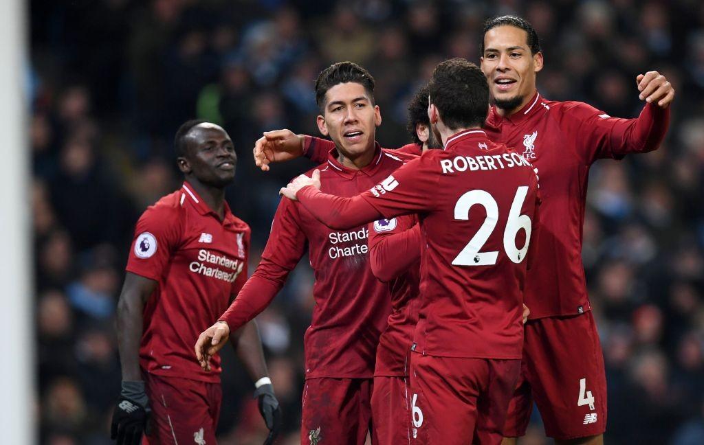Para pemain Liverpool saat merayakan gol Roberto Firmino ke gawang Manchester City (Foto: AFP/Paul Ellis)