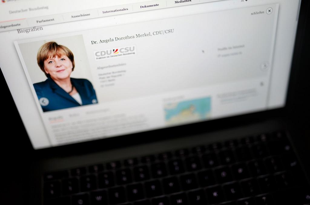 Foto Kanselir Angela Merkel berada di situs milik parlemen Jerman. (Foto: AFP/ODD ANDERSEN)