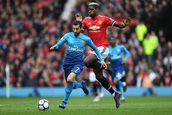 Pemain Manchester United Paul Pogba dan pemain Arsenal Henrikh Mkhitaryan (Foto:AFP/Paul Ells)