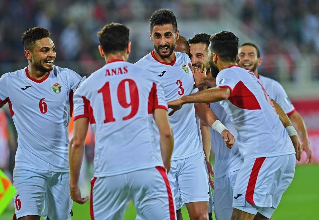 Pemain Yordania merayakan kemenangan mereka atas Suriah (AFP/Giuseppe Cacace)