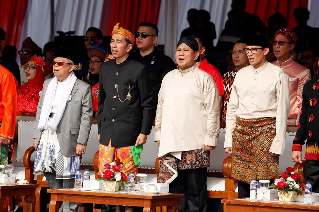 pasangan capres-cawapres nomor urut 01, Joko Widodo-Ma'ruf Amin, serta pasangan Capres-Cawapres nomor urut 02, Prabowo Subianto-Sandiaga Uno saat deklarasi kampanye damai di Monas, Jakarta. (MI/Rommy Pujianto)