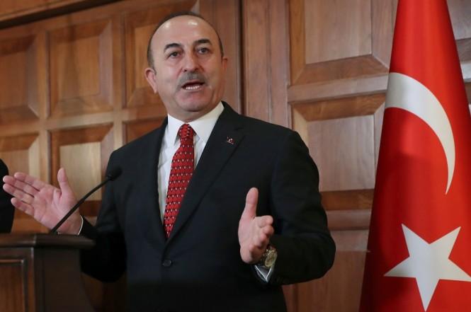 Menlu Turki Mevlut Cavusoglu dalam konferensi pers di Ankara, 14 Januari 2019. (Foto: AFP/ADEM ALTAN)