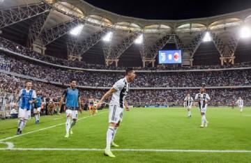 Selebrasi Cristiano Ronaldo usai membobol gawang AC Milan di