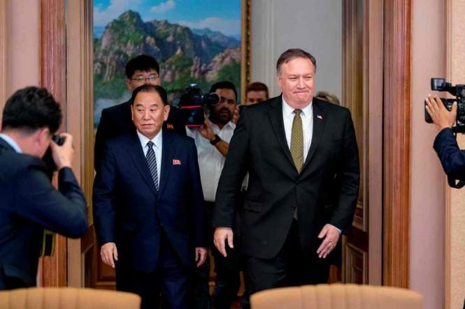 Kim Yong-chol (kiri) dan Mike Pompeo ketika bertemu di Pyongyang, Juli 2018. (Foto: AFP)