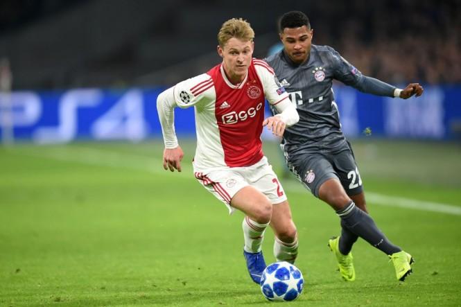 Frenkie de Jong saat Ajax berhadapan dengan Bayern Muenchen di Liga Champions 2018-2019. (Foto: JOHN THYS / AFP)