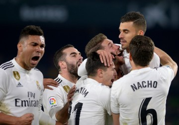 Real Madrid akan menghadapi lawan kuat Sevilla di Santiago
