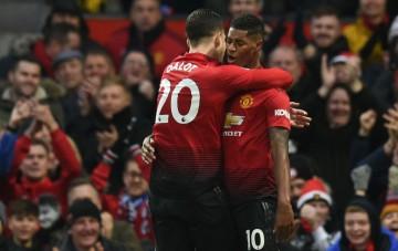 Momen saat Marcus Rashford merayakan golnya bersama Diogo Dalot