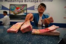 Rupiah Ditaksir Bergerak ke Rp14.200/USD