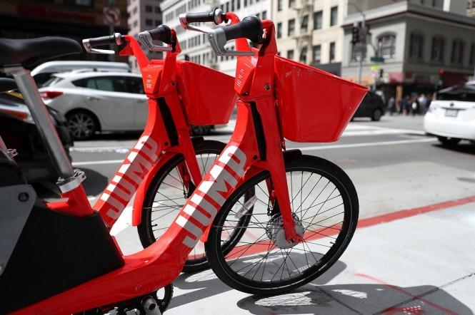 Uber mempertimbangkan untuk mengembangkan sepeda dan skuter otonom. (Justin Sullivan/Getty Images/AFP)