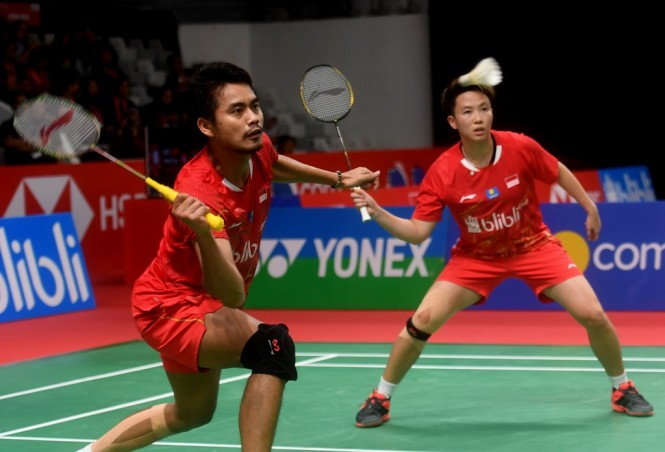 Tontowi Ahmad/Liliyana Natsir saat tampil di babak pertama Indonesia Masters 2019. (Foto: ANTARA FOTO/Akbar Nugroho Gumay)