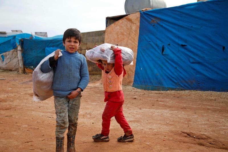 Anak-anak di Suriah harus mengungsi akibat konflik di negaranya. (Foto: AFP).