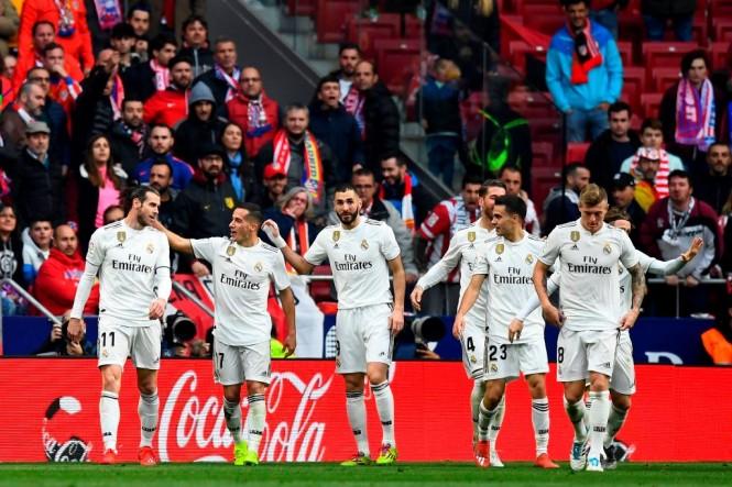 Real Madrid berhasil mengalahkan Atletico Madrid dengan skor 3-1 (Foto AFP/GABRIEL BOUYS)