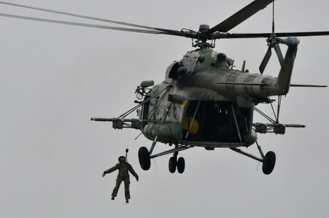 Helikopter tipe MI-8. (Foto: AFP/GENYA SAVILOV)