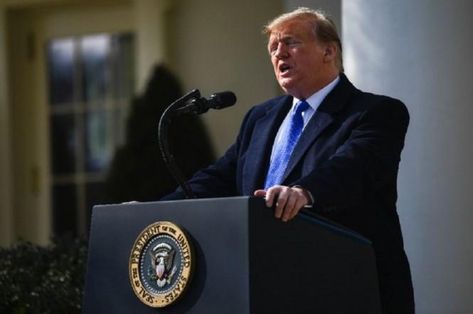 Presiden Dpnald Trump menyatakan hendak mendeklarasikan status darurat, Jumat 15 Februari 2019. (Foto: AFP Photo/Brendan Smialowski)