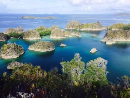 Octogenarian Woman Scales Piaynemo Top in Raja Ampat