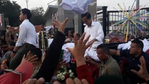 Jokowi-Maruf Diarak Keluar GBK