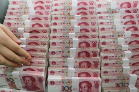 Yuan Terlibas Keperkasaan Dolar AS