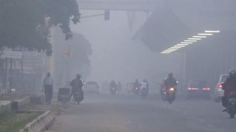 Palembang Diselimuti Kabut Asap Kiriman