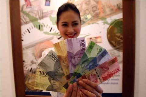 Rupiah Pagi Menguat Tipis di Rp14.084/USD