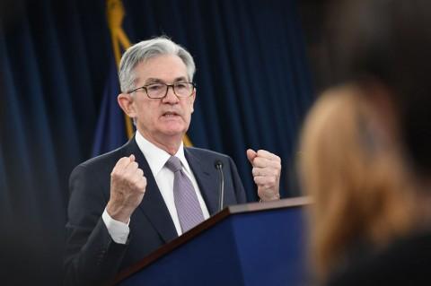 The Fed Tahan Suku Bunga