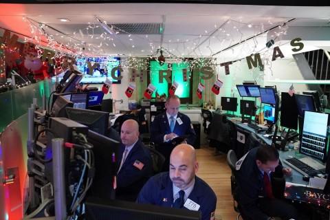Wall Street Menanjak Usai The Fed Pertahankan Suku Bunga
