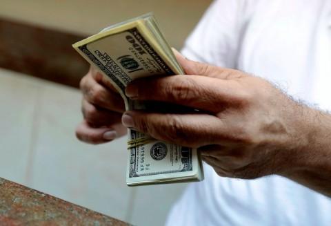 Dolar AS Terangkat Optimisme Perang Dagang